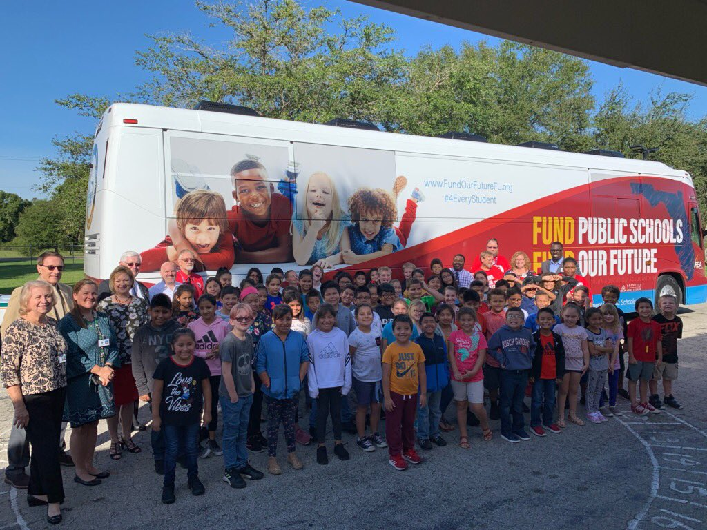 Nocatee Elementary kids with the bus
